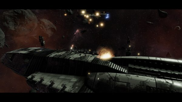 BSG Screenshot. Top of a large Battlestar class starship shoots a distant enemy ship peppered by small explosions.