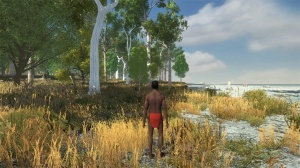 Screenshot of a Nyoongar man standing where grass meets the river's edge, looking along the coastline.